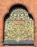 Ancient bass relief showing a big tree on brick wall from 1899. Ancient bass relief showing a big tree on brick wall royalty free stock images