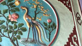 Ancient bass relief on the wall. At the Chinese church in the centre Hoi An, Vietnam stock video
