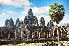 Ancient Bayon temple, Angkor Thom , the most popular tourist attraction in Siem reap, Cambodia. Massive stone faces carved into the sides of Wat Royalty Free Stock Images