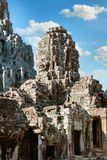 Ancient Bayon temple, Angkor Thom , the most popular tourist attraction in Siem reap, Cambodia. Massive stone faces carved into the sides of Wat Royalty Free Stock Photos