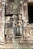 Ancient Bayon temple, Angkor Thom , the most popular tourist attraction in Siem reap, Cambodia. Bas-relief and close up stone, columns Stock Photography