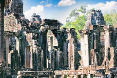Ancient Bayon temple, Angkor Thom , the most popular tourist attraction in Siem reap, Cambodia. Massive stone faces carved into the sides of Wat Stock Photos