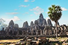 Ancient Bayon temple, Angkor Thom , the most popular tourist attraction in Siem reap, Cambodia. Massive stone faces carved into the sides of Wat Stock Photography