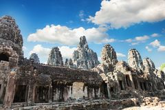 Ancient Bayon temple, Angkor Thom , the most popular tourist attraction in Siem reap, Cambodia. Massive stone faces carved into the sides of Wat Stock Images