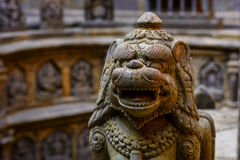 Stone crafted ancient lion in Lalitpur Nepal. The ancient beast gurading the sacred temple, Lalitpur Nepal Royalty Free Stock Images