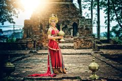 Ancient asian woman wear traditionnel thai dress, Thailand style royalty free stock image