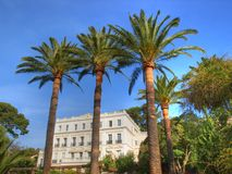 Ancient and beautuful french riviera villa. Ancient villa  Henri-Joseph among plam trees in Hyeres on french riviera Royalty Free Stock Image