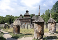 Ancient beehives nearby wooden church Royalty Free Stock Image