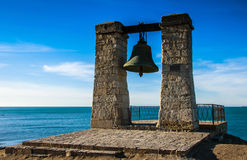 Ancient bell against sea Royalty Free Stock Image