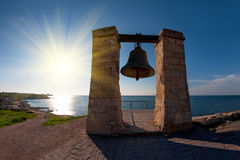 Ancient bell on the coast Stock Photography