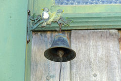 Ancient bell on front door of the historic city Stock Image