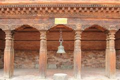 An ancient bell hanging at Patan Museum in Patan, Nepal Stock Images