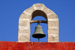 Ancient bell hanging on the stone arch. In Arequipa, Peru Stock Photos