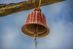 A new perspective from a ancient bell. Ancient bell, a new perspective under de cloudy sky on the north of Peru in Latin America Royalty Free Stock Photography