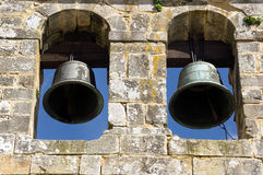 Ancient bell tower with bells and blue sky Royalty Free Stock Image