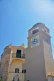 Ancient bell tower with a clock in Capri Stock Photo