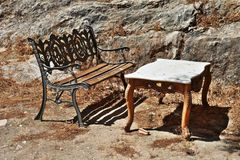 Ancient bench and table. Royalty Free Stock Photo