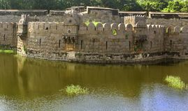 Ancient big battlement of vellore fort with trees. A ruined fort battlement with trees at Vellore fort is a large 16th-century fort situated in the Vellore city Stock Image