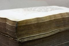 Ancient big book with old yellow pages close-up stock photos
