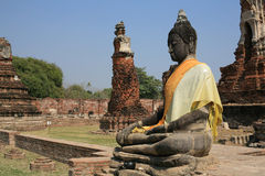 Ancient big buddha statue at ruined temple Stock Photography