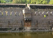 Ancient big ornamental wall of vellore fort with trees. A ruined fort battlement with trees at Vellore fort is a large 16th-century fort situated in the Vellore Royalty Free Stock Photography