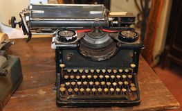 Ancient black rusty typewriter with round  keys Stock Photography
