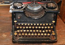 Ancient black rusty typewriter used by typists than once Royalty Free Stock Image