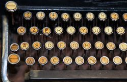 Ancient black rusty typewriter with white keys Stock Images