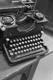 Ancient black rusty typewriter with white keys Royalty Free Stock Image