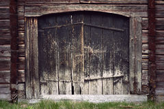 Ancient black wooden door Stock Image