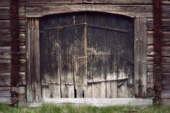 Ancient black wooden door stock image