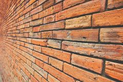Ancient block wall with brown and orange tone, Side or Oblique view, Old square pattern, Texture background. stock image