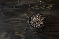Blue bowl full of coffee bean Royalty Free Stock Images