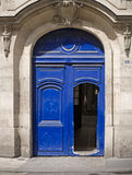Ancient blue wooden opened door Stock Image