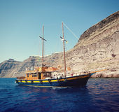 Ancient boats. Ancient travel boat without sail floats to the port Stock Image