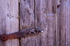 Ancient bolt on the door in the village royalty free stock photo