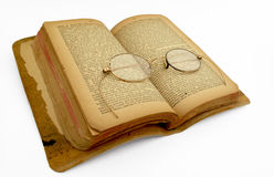 Ancient Book with antique glasses Royalty Free Stock Images