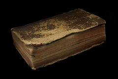 Ancient book on black background. Ancient worn off book on black background royalty free stock photos