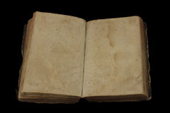 Ancient book with blank pages for custom text. On black background stock images