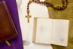 Ancient book with Catholic cross Royalty Free Stock Image