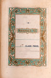 Ancient book first prize dedication label. Printed insert dedicating a book as a first prize with an art nouveau style border on a pale green background.  About Royalty Free Stock Images