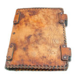 The ancient book in leather cover Stock Photos