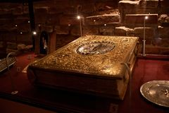 TRAKAI, LITHUANIA - JANUARY 02, 2013: Ancient book in Museum of Sacred Art. Ancient book in Museum of Sacred Art part of the Trakai Historical Museum, opened in stock photo