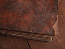 Ancient book on the old wooden table Stock Photography