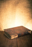 Ancient book on the old wooden table. Toned Royalty Free Stock Photography
