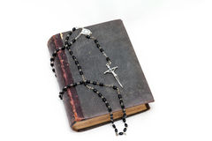 Ancient book and prayer beads. Ancient book and rosary Catholic (prayer beads Royalty Free Stock Photos