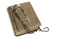 Ancient book and prayer beads. Ancient book and rosary Catholic (prayer beads Stock Images