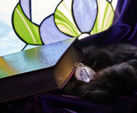 Ancient Book of Sacred Time with Watch Clock and Stained Glass Royalty Free Stock Photography