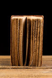 Ancient book shot on black background Royalty Free Stock Photos