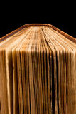 Ancient book shot on black background Royalty Free Stock Image